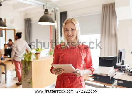 business, startup and people concept - happy businesswoman or creative female office worker with tablet pc computer - stock photo