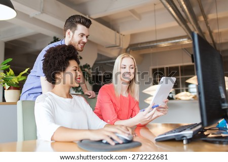 business, startup and people concept - happy creative team with computer and notebook in office - stock photo