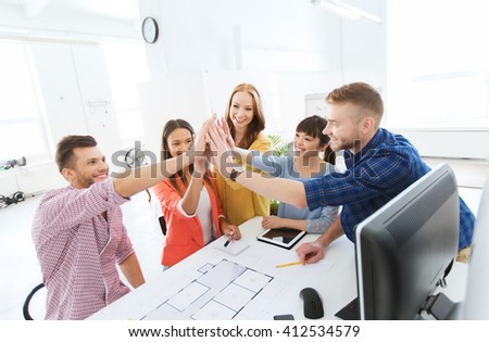 business, startup, architecture, gesture and people concept - happy international creative architect team or students with blueprint making high five at office - stock photo