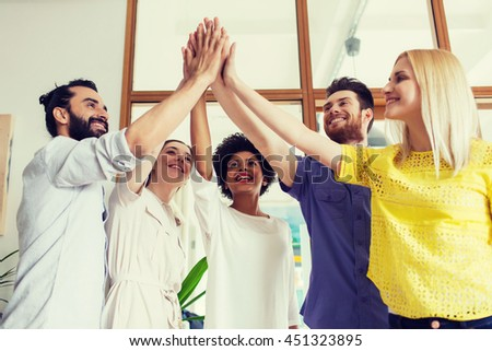 business, startup, gesture, people and teamwork concept - happy creative team making high five in office - stock photo
