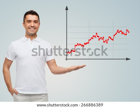 business, statistics, economics, success and people concept - smiling man showing growing chart over gray background - stock photo