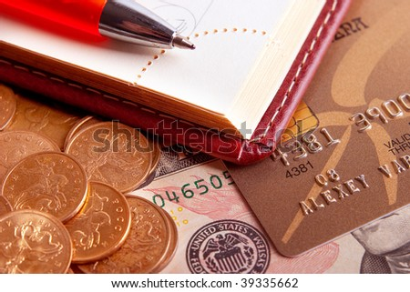 Business still-life: a pen, a diary and money - stock photo