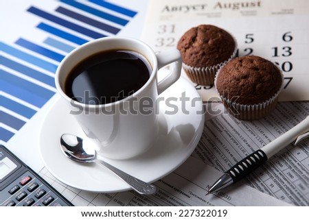 business still life and cup of coffee with newspapers - stock photo