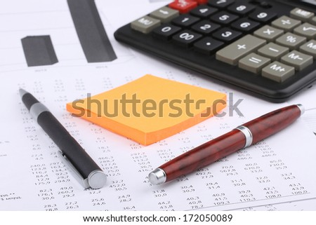 Business still-life of pen, charts, calculator, tables, sticker - stock photo