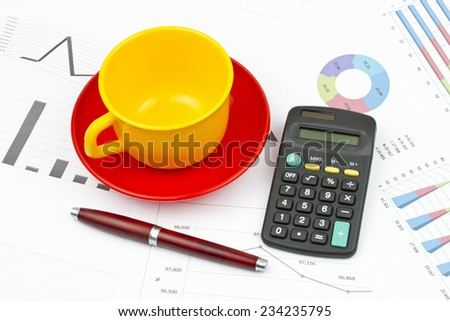 Business still life of pen, cup, saucer, calculator - stock photo