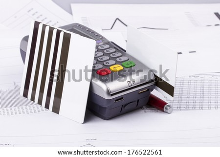 Business still-life of tables, payment terminal, credit Cards, eyeglasses, pen