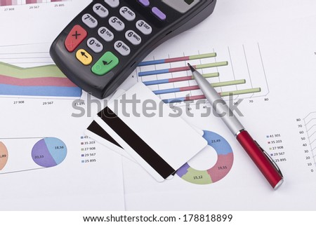 Business still-life of tables, payment terminal, credit Cards, pen