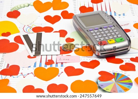 Business still-life of the coins, payment terminal, credit cards, text message, many heart - stock photo