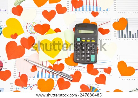 Business still-life of the red pen, coins, text message, calculator, many heart - stock photo
