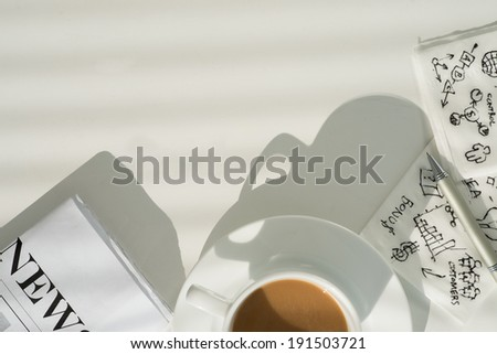 Business still life with cup of coffee, newspaper and napkins - stock photo