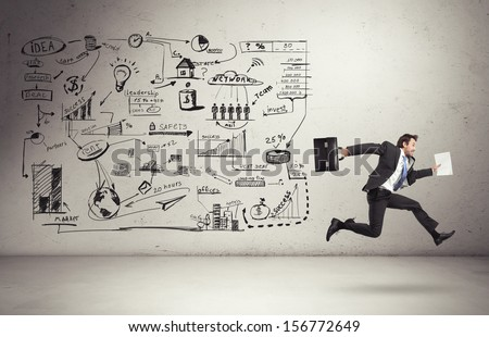 business strategy on a wall and running businessman - stock photo