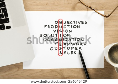 business strategy plan crossword puzzle on the office desk - stock photo