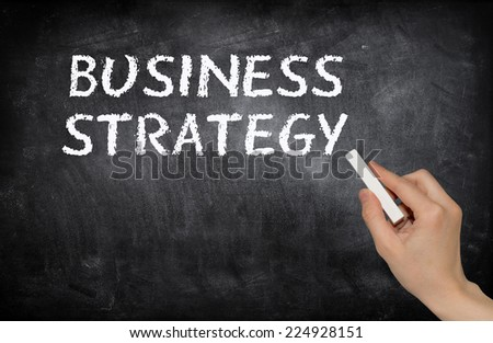 Business strategy, written with white chalk on a blackboard - stock photo