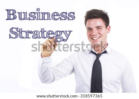 Business Strategy - Young smiling businessman writing on transparent surface