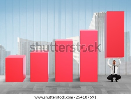 Business strongman with effort lifts company statistics - stock photo