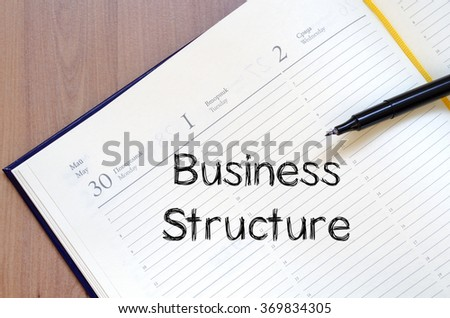 Business structure text concept write on notebook with pen