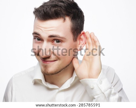 business, success and people concept - Young business man hearing something over white background  - stock photo