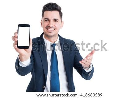 Business, success and technology concept with businessman showing smartphone with blank screen and copy space isolated on white - stock photo