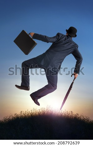 business success concept businessman kicking heels in the air  - stock photo