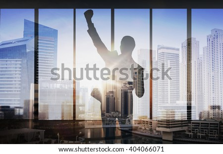 business, success, gesture and people concept - silhouette of happy businessman raising fist and celebrating victory over double exposure office and city background - stock photo