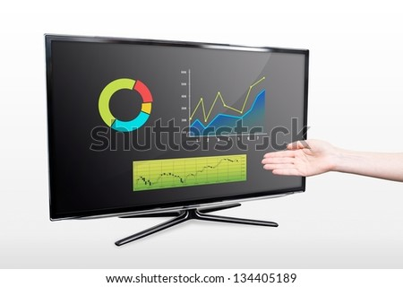 Business success growth chart. Hand showing modern TV screen - stock photo