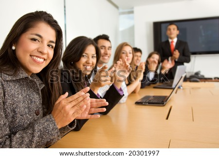 business success team in an office clapping a presentation - stock photo