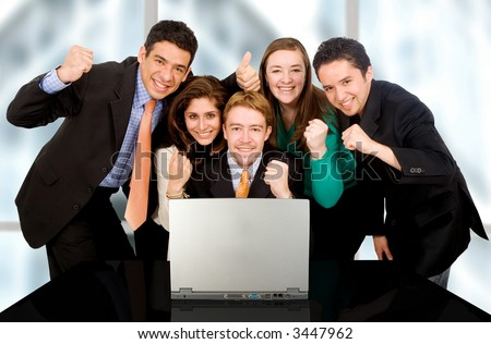 Business success team in an office in front of a laptop computer - stock photo