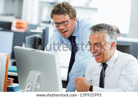 Business success team in an office in front of a screen computer - stock photo