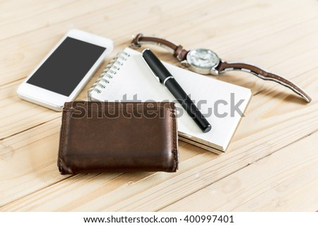 business successful man accessories, notepaper, pen, wristwatch, wallet, smart phone - stock photo