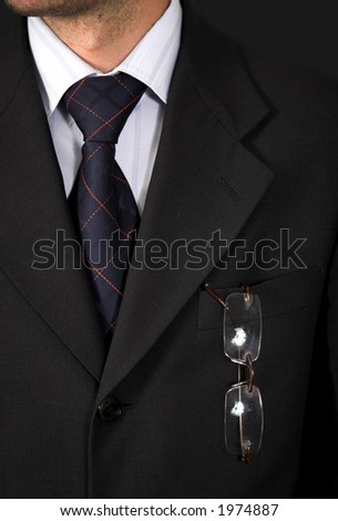 business suit over a black background