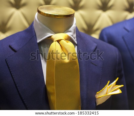 Business suits on shop mannequins high fashion retail display - stock photo