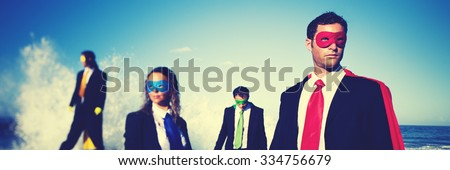 Business superheroes on the beach confident concept - stock photo