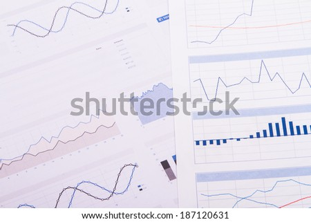 Business table with bar chart graphs. - stock photo