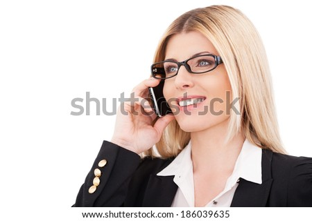 Business talk. Beautiful mature businesswoman talking on the mobile phone and smiling while standing isolated on white - stock photo