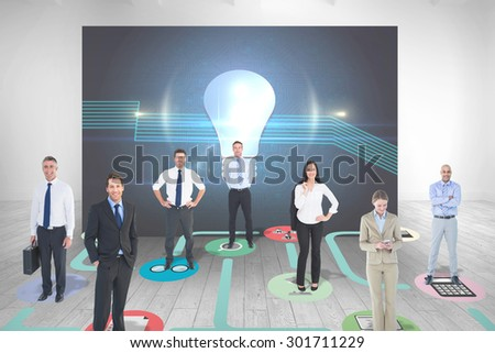 Business team against room with futuristic picture of light bulb - stock photo