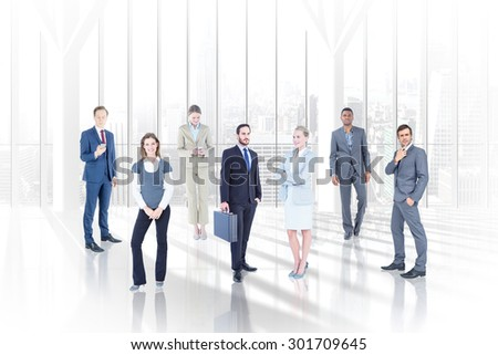 Business team against white room with large window overlooking city - stock photo