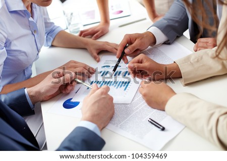 Business team analyzing current situation in the company to gain better future results - stock photo