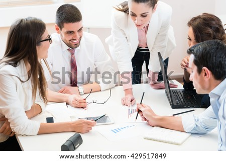 Business team analyzing data and discussing strategy in joint work