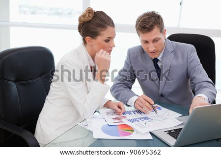 Business team analyzing market research data - stock photo