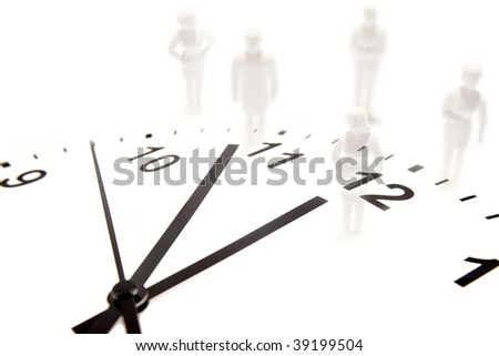 Business team and clock on white.