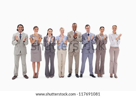 Business team applauding against white background - stock photo