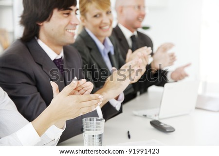 business team applauding at a conference or board meeting - stock photo