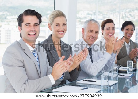 Business team applauding during conference in the office - stock photo