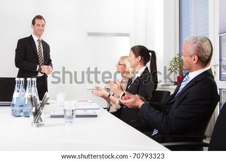 Business team applauding to presentation - stock photo