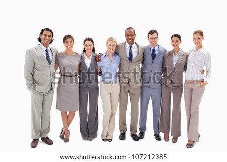 Business team arm in arm against white background