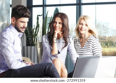 Business team at office. Portrait of businesswomen and businessman sitting at desk in front of computer and consulting from financial plan.  - stock photo
