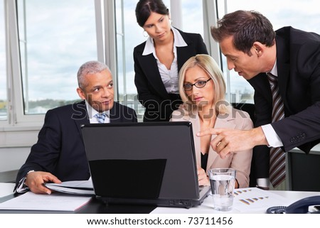 Business team at the meeting - stock photo