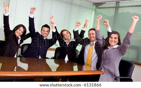 business team at the office all celebrating their success