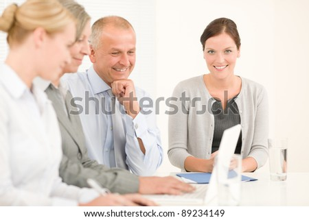 Business team attractive businesswomen with happy colleagues working around table