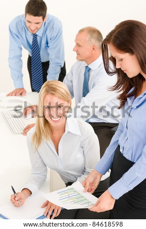 Business team attractive businesswomen with happy colleagues working on charts
